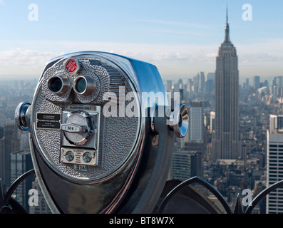 Public pay viewing coin operated binoculars on Top of The Rock observation platform at Rockefeller Center in Manhattan - Stock Photo