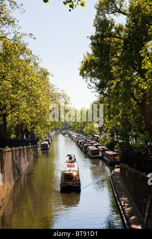 Narrow canal boat passing through Little Venice, London in May 2010 - Stock Photo