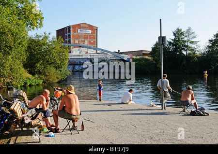 Anglers in summer at the Berlin-Spandau Schifffahrtskanal channel, once the border with East Germany, Berlin, Germany, - Stock Photo