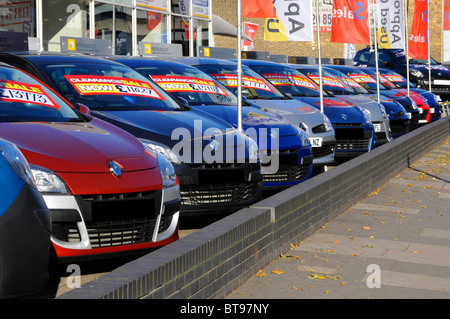 East London Renault car dealer forecourt display of cars with clearance sale price labels - Stock Photo