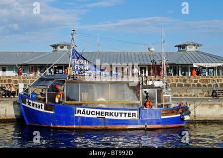 Sale of fresh and smoked fish on the smoking cutter in the Baltic resort Sassnitz, Jasmund peninsula, Ruegen Island