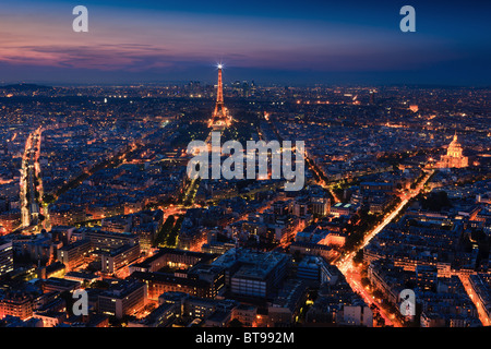 Sunset in Paris with the view from the Tour Montparnasse Tower on the Eiffeltower - Stock Photo
