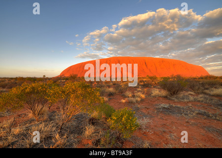 Uluru, Ayers Rock at sunrise, Uluru-Kata Tjuta National Park, Northern Territory, Australia - Stock Photo