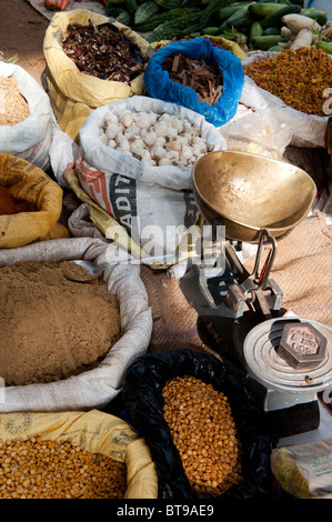 Indian market stall with sacks of indian spices and dried produce. Puttaparthi, Andhra Pradesh, India - Stock Photo