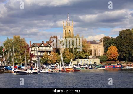 St Mary's Church and Hampton Sailing Club on the River Thames at Hampton, England UK. - Stock Photo