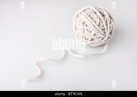 Clew of gray wool yarn on the neutral background - Stock Photo