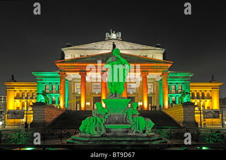 Schiller monument in front of the Konzerthaus concert hall on the Gendarmenmarkt square, illuminated for the Festival - Stock Photo