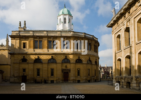 The Sheldonian Theatre (designed by Sir Christopher Wren) in Oxford with the Clarendon Building to its right - Stock Photo