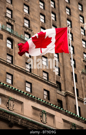 Canadian flag fluttering in the breeze - Stock Photo