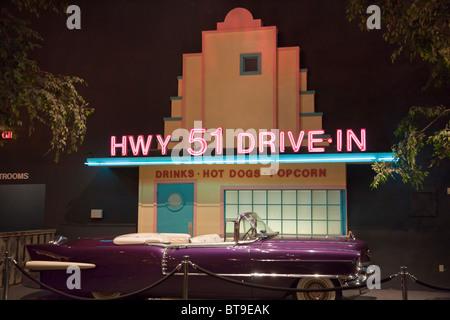 Elvis' purple Cadillac 1956 Eldorado outside fake frontage of Highway 51 drive-In; automobile museum Graceland, - Stock Photo
