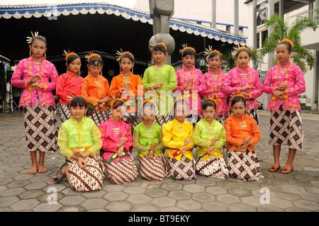 Students at a student performance of a traditional Javanese dance theater piece, Ramayama, Yogyakarta, Java, Indonesia - Stock Photo