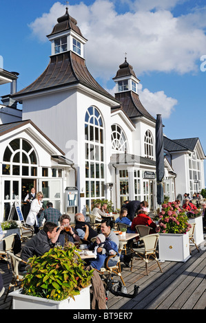Guests at the cafe on the pier in the Baltic resort Sellin, Ruegen Island, Mecklenburg-Western Pomerania, Germany, - Stock Photo