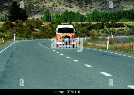 Volkswagen Combi van traveling on a road in the south Island of New Zealand - Stock Photo
