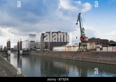 View towards Schwanentor Bridge, Duisburg Inner Harbour, in front of the historic crane of the RSWG, North Rhine - Stock Photo