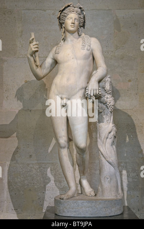 Statue of Bacchus Roman or Dionysus Greek God of grape harvest, winemaking and wine, Louvre Museum Paris - Stock Photo
