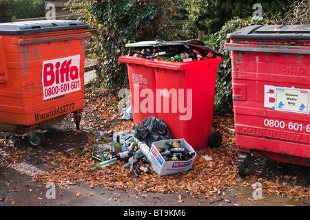 Overflowing recycling and waste bins - Stock Photo