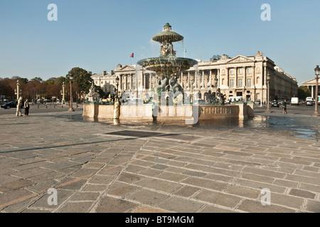 Fountain of River Commerce and Navigation in the place de la Concorde with legendary 5 star luxury Hotel de Crillon - Stock Photo