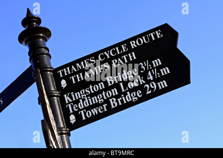 Sign post at Hampton Court Bridge over the River Thames at Molesey. England UK. - Stock Photo