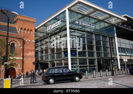 Black taxi cab waiting outside Kings Cross St Pancras station. London. England - Stock Photo