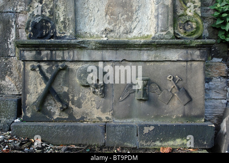 Weathered memorial with various symbols in Old Calton Burial Ground, Edinburgh, Scotland, UK - Stock Photo