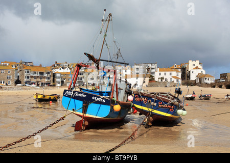 Boats in St Ives harbour captured at low tide - Stock Photo