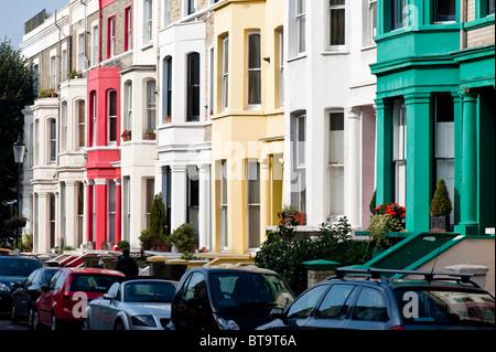 Colourful facades of houses in Ladbroke Grove area, W11, London, United Kingdom - Stock Photo