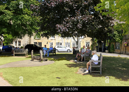 The village green with medieval stocks at Stow-On-The-Wold Gloucestershire - Stock Photo