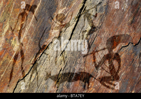 Primitive figures on the rock looks like cave painting - Stock Photo