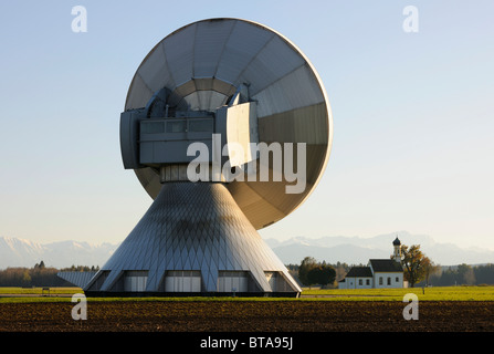Earth station, parabolic aerial, pilgrimage church St. Johannes, Raisting, Bavaria, Germany, Europe - Stock Photo