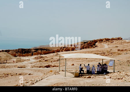 Masada communing with the past - Stock Photo