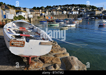 Boats in Mousehole Harbour, Cornwall - Stock Photo