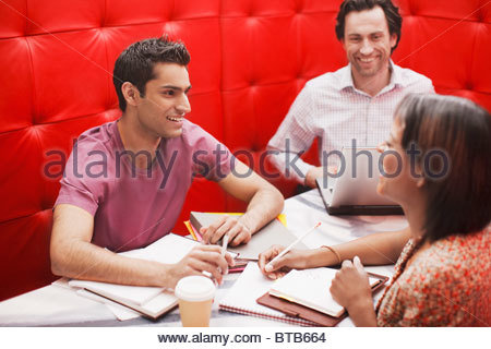 Smiling business people in meeting - Stock Photo