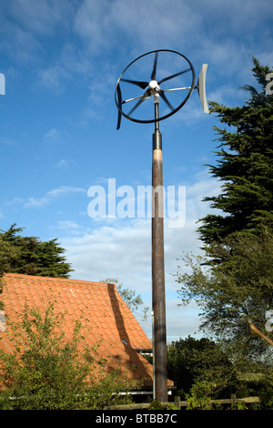 Domestic wind turbine generating electricity for home use - Stock Photo