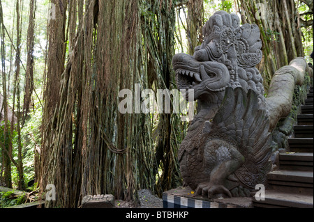 Stone Dragon Guarding the Bridge at the Sacred Monkey Forest Sanctuary and Temple in Ubud, Bali - Stock Photo