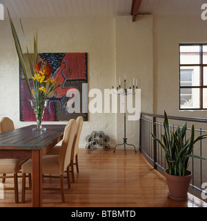 White flooring in large dining and living room in open for Large paintings for dining room