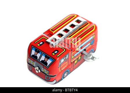 Tin toy, fire engine, wind up motor by a metal key. - Stock Photo