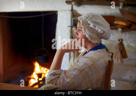 A costumed historical interpreter portraying the Farm Wife at Claude Moore Colonial Farm, McLean, Virginia. - Stock Photo