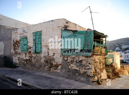 Old decrepit house in the city of Ermoupolis, island of Syros, Greece - Stock Photo