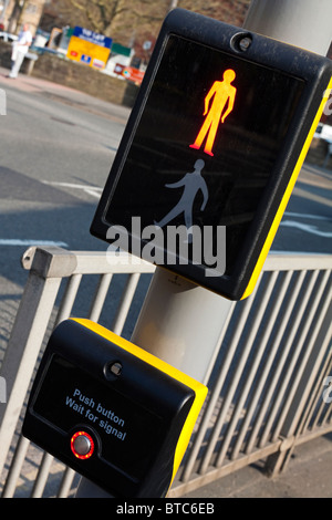 Detail of push button panel on UK Pelican Crossing for pedestrians next to busy road - Stock Photo