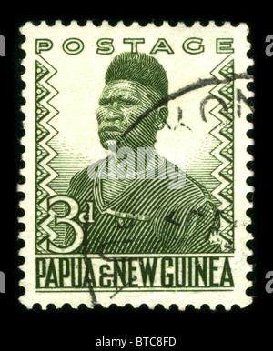 Papua New Guinea - CIRCA 1970: A stamp printed in Papua New Guinea shows image portrait Aborigine circa 1970. - Stock Photo