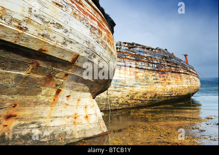 Derelict boats in Salen Bay on the Isle of Mull - Stock Photo