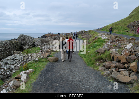 Visitors to the Giants Causeway, County Antrim, Northern Ireland - Stock Photo