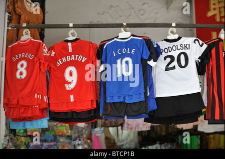 Fake football shirts on sale in Kuching, Sarawak, Malaysia - Stock Photo