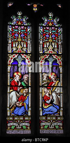 A stained glass window depicting Jesus in the house of Mary and Martha of Bethany - Stock Photo