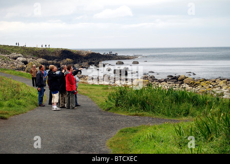 Visitors at the Giants Causeway, County Antrim, Northern Ireland - Stock Photo