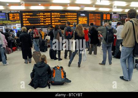 Passengers waiting on concourse Kings Cross Station London England Britain UK - Stock Photo