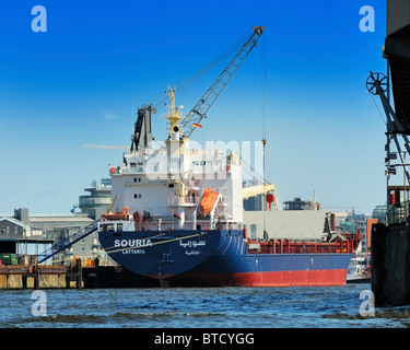SOURIA (callsign), a dry cargo vessel sailing under the flag of Syrian Arab Republic, is loaded at the Port of Hamburg, - Stock Photo