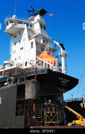 The EURO STORM container ship in a dry dock at the Port of Hamburg, Germany. - Stock Photo