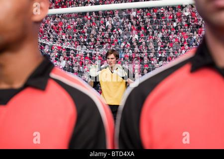 Free kick during a football match - Stock Photo