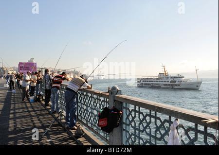 Ferries and Fishermen on the Galata Bridge, İstanbul, Turkey 100916 35949 - Stock Photo